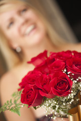 Blonde Woman Accepts Gift of Red Roses