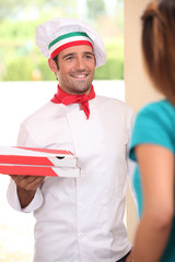 Man delivering freshly baked pizzas