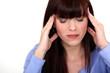 portrait of young woman having headache