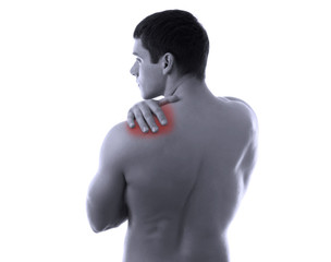 A man having pain in his back, back-view