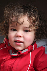 Kid wearing coat outdoors