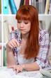 Redhead girl doing homework