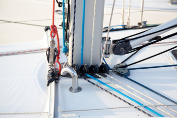 Detail of sailboat mast bottom with ropes