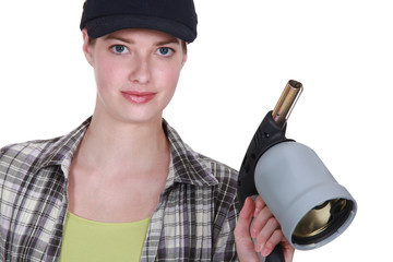 Blond welder holding blow torch