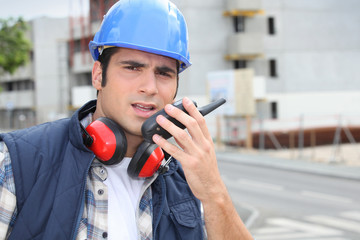Foreman with a walkie talkie