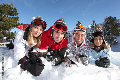 Four friends on skiing holiday