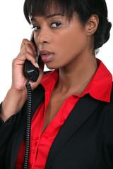 Businesswoman using a landline