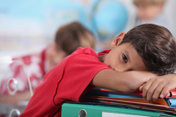 sleepy boy in classroom