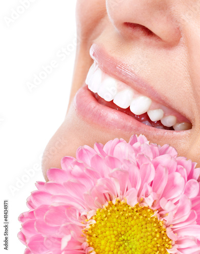 Beautiful woman face with flower.