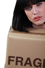 brunette slumped on removal box