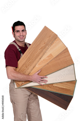 Carpenter holding plywood