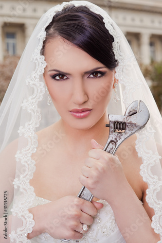 Angry bride holding wrench