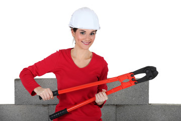 Woman holding large pliers