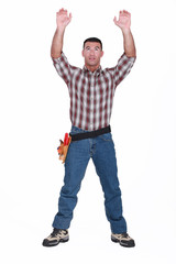 Tradesman reaching for an object