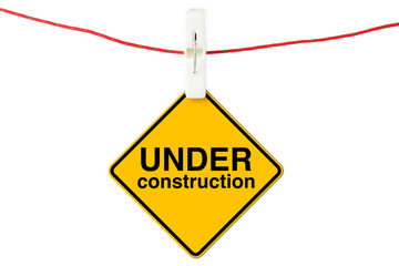 Under Construction sign with clothesline