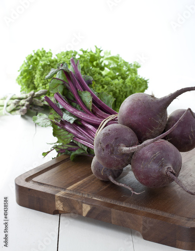 Fresh beetroot from farmers market on dark wooden board