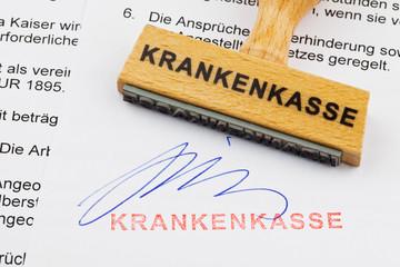 Holzstempel auf Dokument: Krankenkasse
