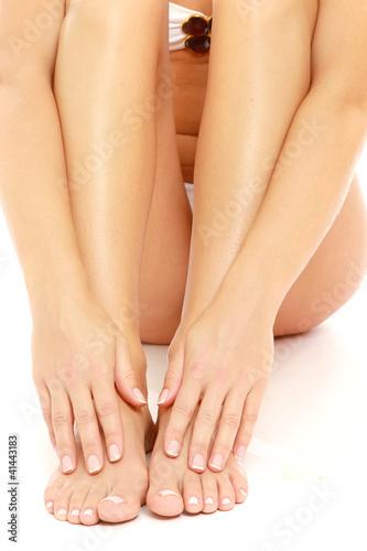 A woman massaging her feet, closeup