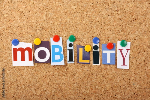 The word Mobility in letters pinned to a cork board