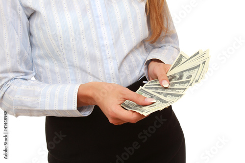 Closeup of dollars in female hands, isolated on white