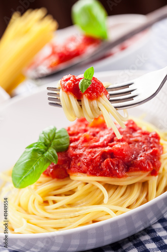 Spaghetti with Tomato Sauce on classical home table