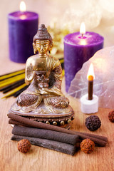 Statue of Buddha, incense, candles and rudraksha