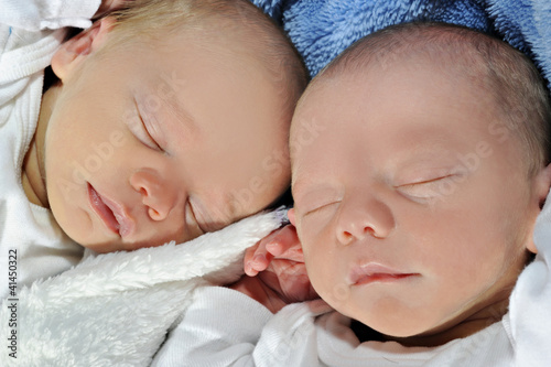Adorable twins sleeping together