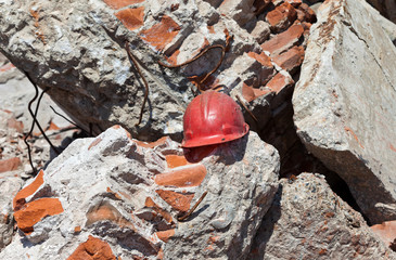 Old construction helmet over ruins