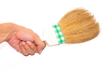 Hand holding broom isolated on white background