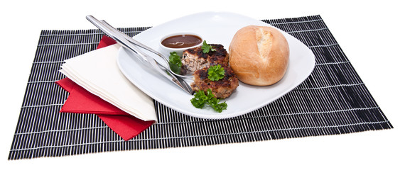 Burger on a plate isolated on white