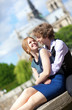 Young romantic couple enjoying warm sunny day in Paris, near the