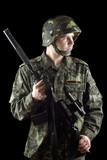 Soldier grasping a gun poster