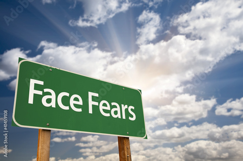 Face Fears Green Road Sign and Clouds