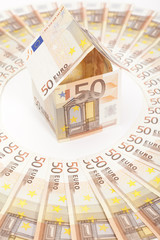 Euro house and banknotes