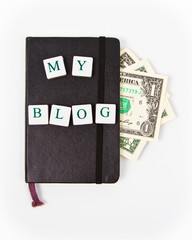 black notepad with my blog message and dollars