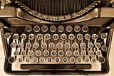 Antique typewriter on sepia