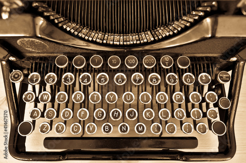 Aluminium Retro Antique typewriter on sepia