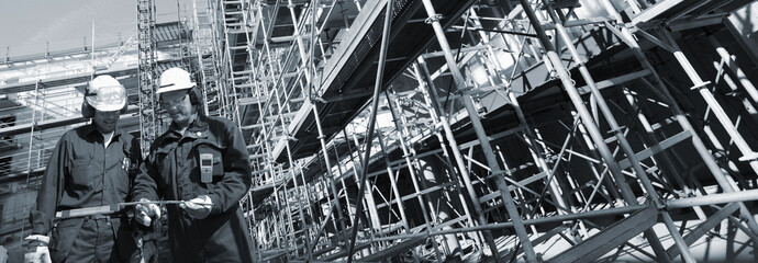 building workers and scaffolding, panoramic view