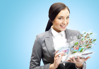 Business woman holding tablet computer. Working on touching scre