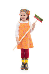 Little girl with broom and rubber boots