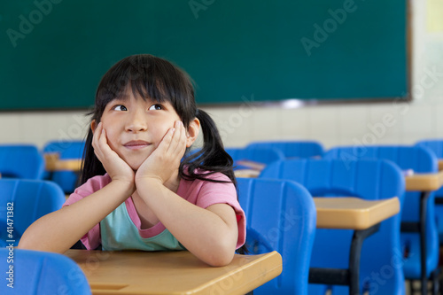 Little Girl are Thinking in the classroom of school