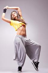young stylish girl dancing