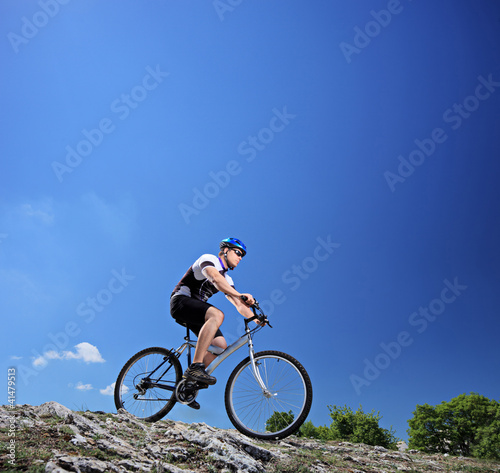 A man riding a mountain bike on a slope