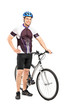 Full length portrait of a young bicyclist posing next to a bicyc