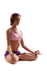 Practicing Yoga. Young woman. Lotus