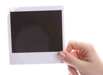 Photo paper in hand isolated on white