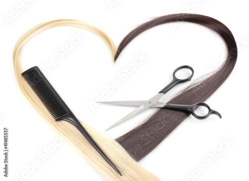 Shiny blond and brown hair with hair cutting shears