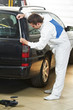 auto mechanic protecting car before polishing