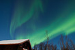 Northern Lights (Aurora Borealis) above a cabin
