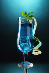 Blue cocktail in glasses on blue background